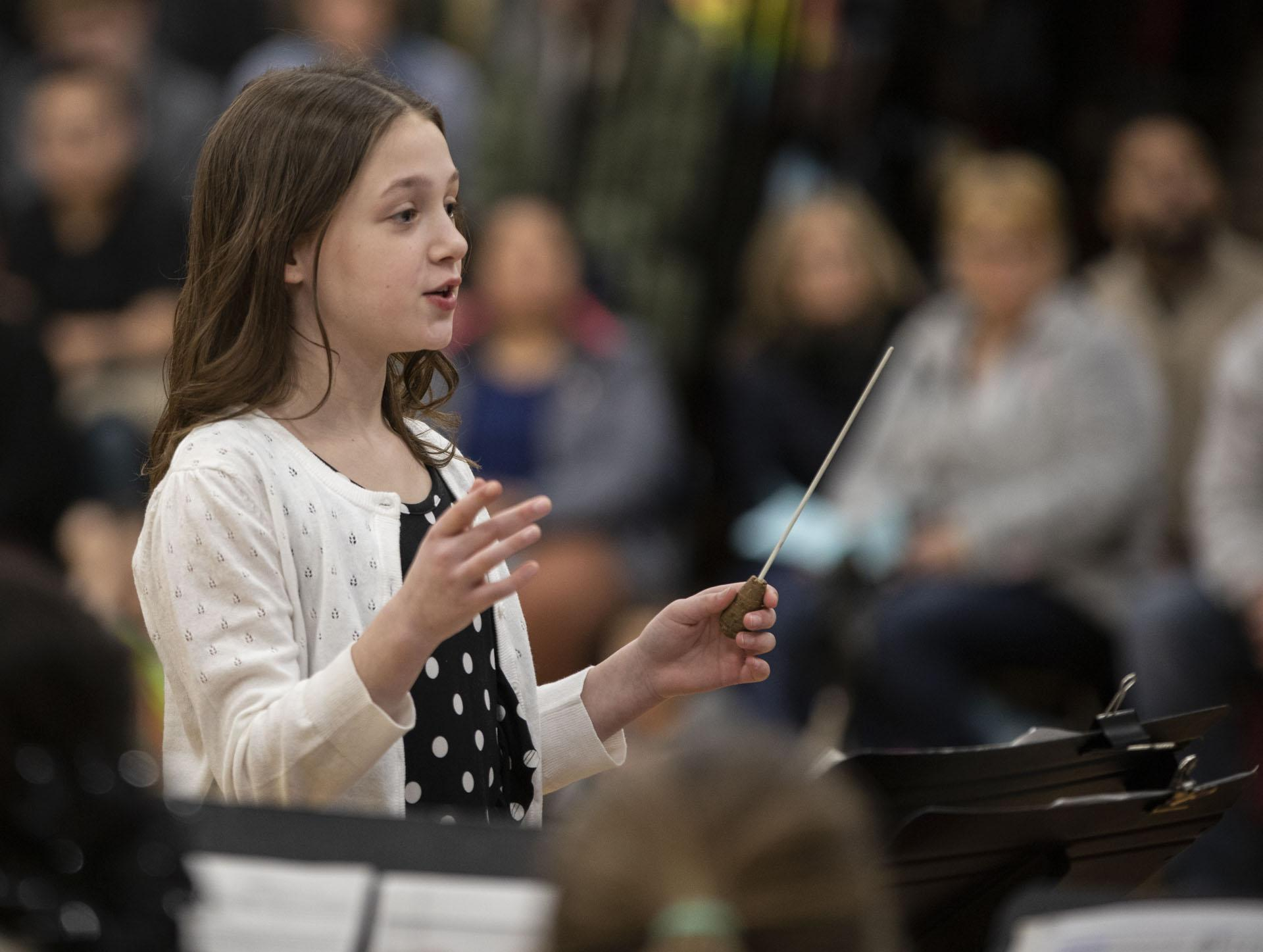 Student conducting concert