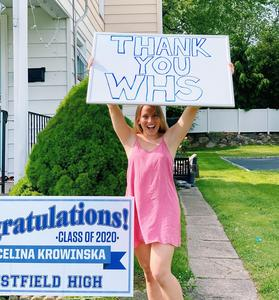 Westfield High School senior Marcelina Krowinska thanks her teachers for their surprise visit to drop off a lawn sign, part of a surprise event for all 12th graders on May 27,organized by the WHS PTSO, with the help of the Westfield community.