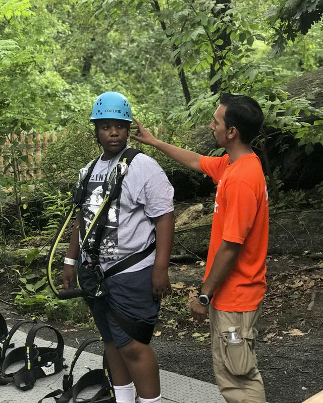 A student ready for his zipline trip