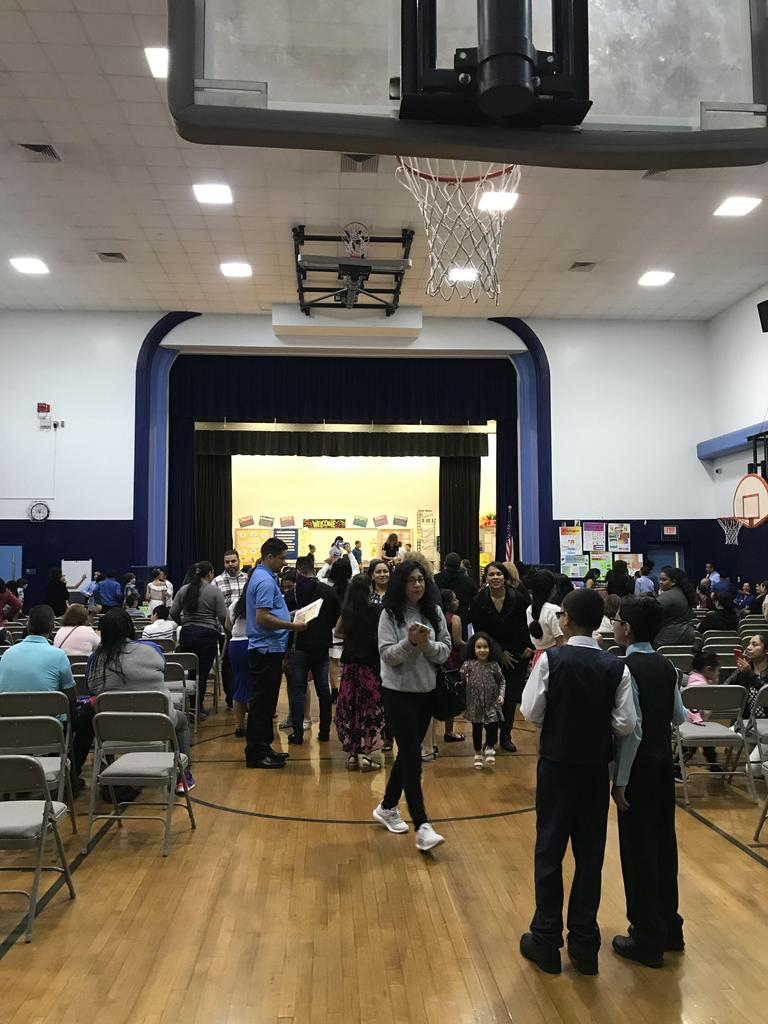 parent and families taking their seats