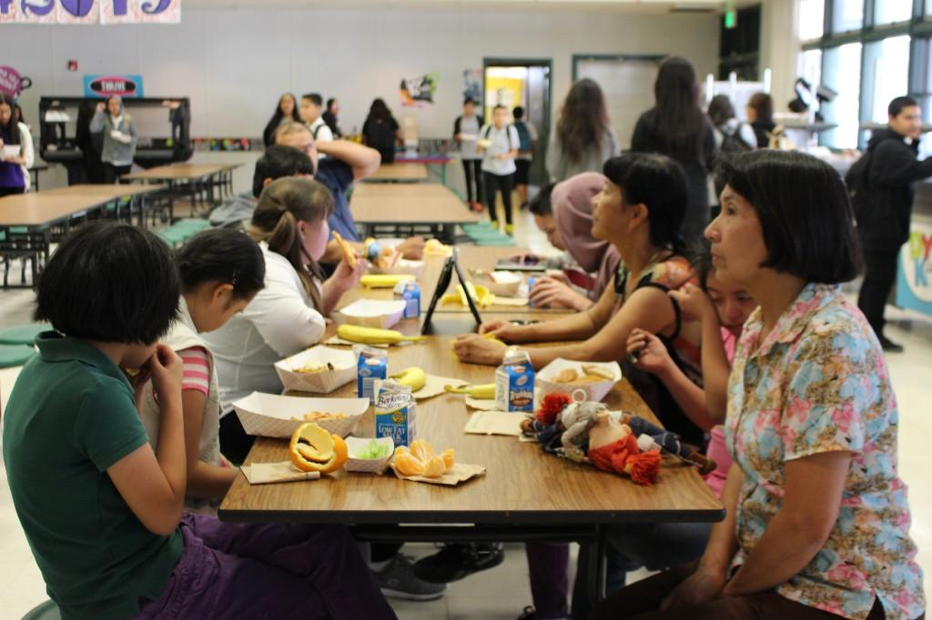 students and teachers eating lunch in the school cafeteria
