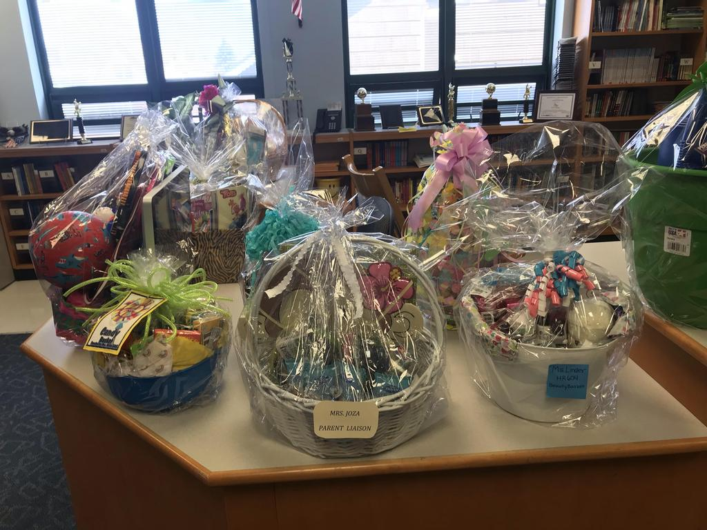 five themed baskets on a table ready for family bingo