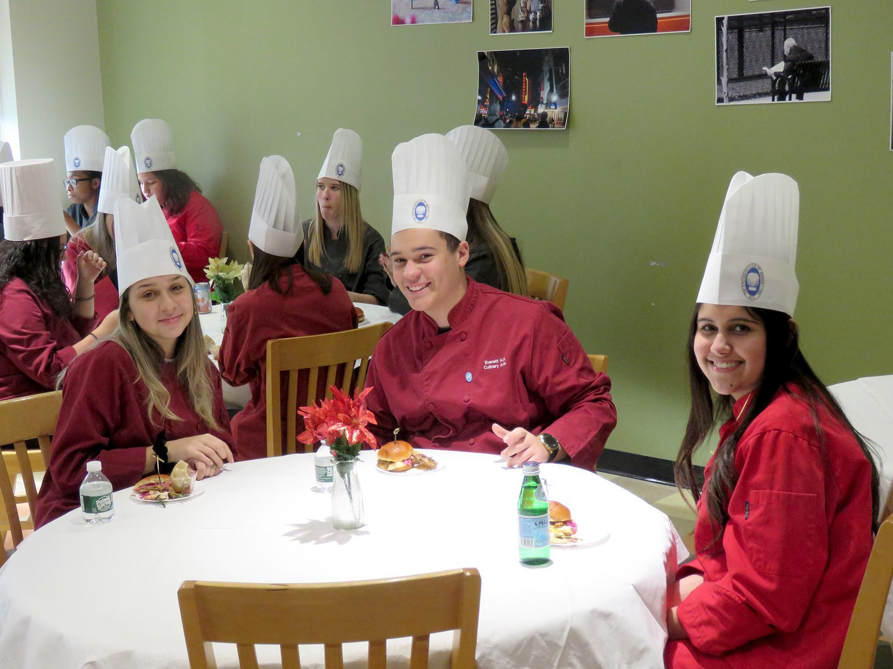 Three EHS students at a table