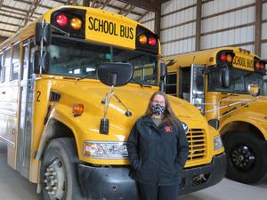TK Bus Driver Sue Mugridge stands beside her TK Bus #2.