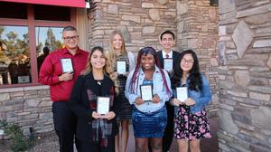 Olivia Necochea, Elyjah Smith Carter, Briana McGeilberry, Rodrigo Villa, Rebecca Abeyratne, and Jasmine Jonson with their Student of the Month plaques smiling for the camera.