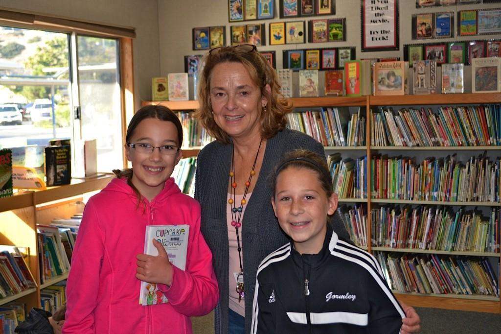 Mrs. Ahlgren with students in the library
