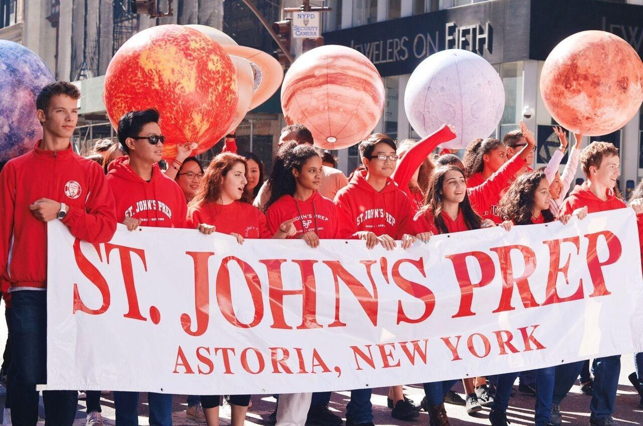 Students with St. John's banner at parade