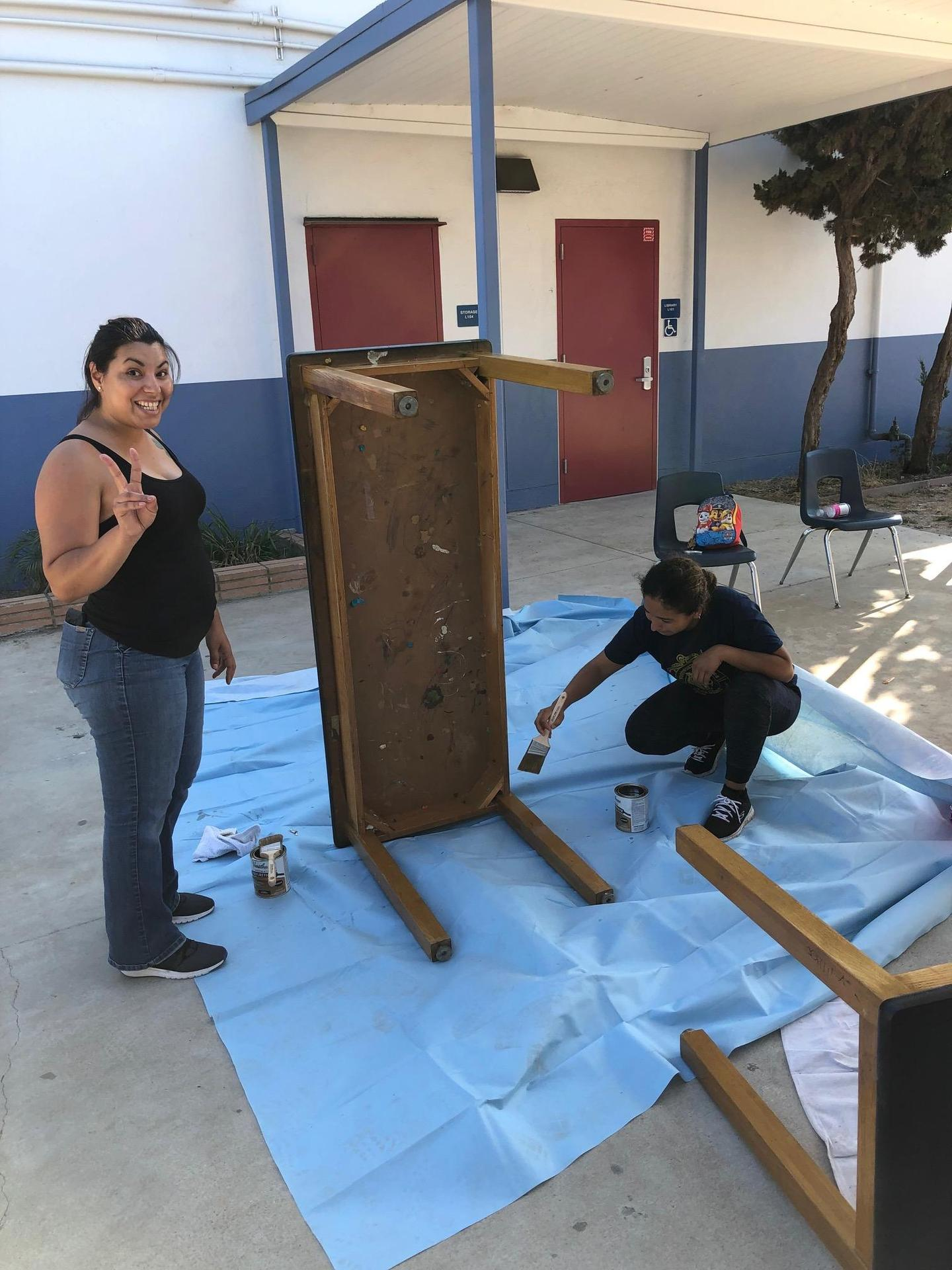 Mariner Makeover Crew sanding and refinishing science tables