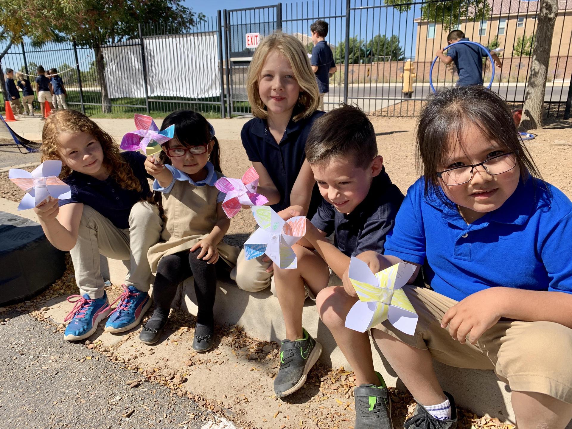 Student show their pinwheels