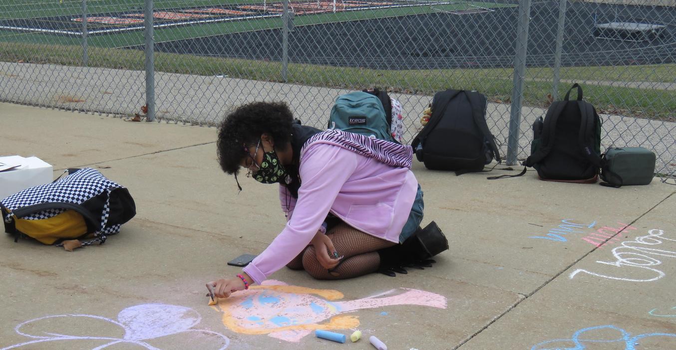 TKHS student creates chalk art outside the high school.