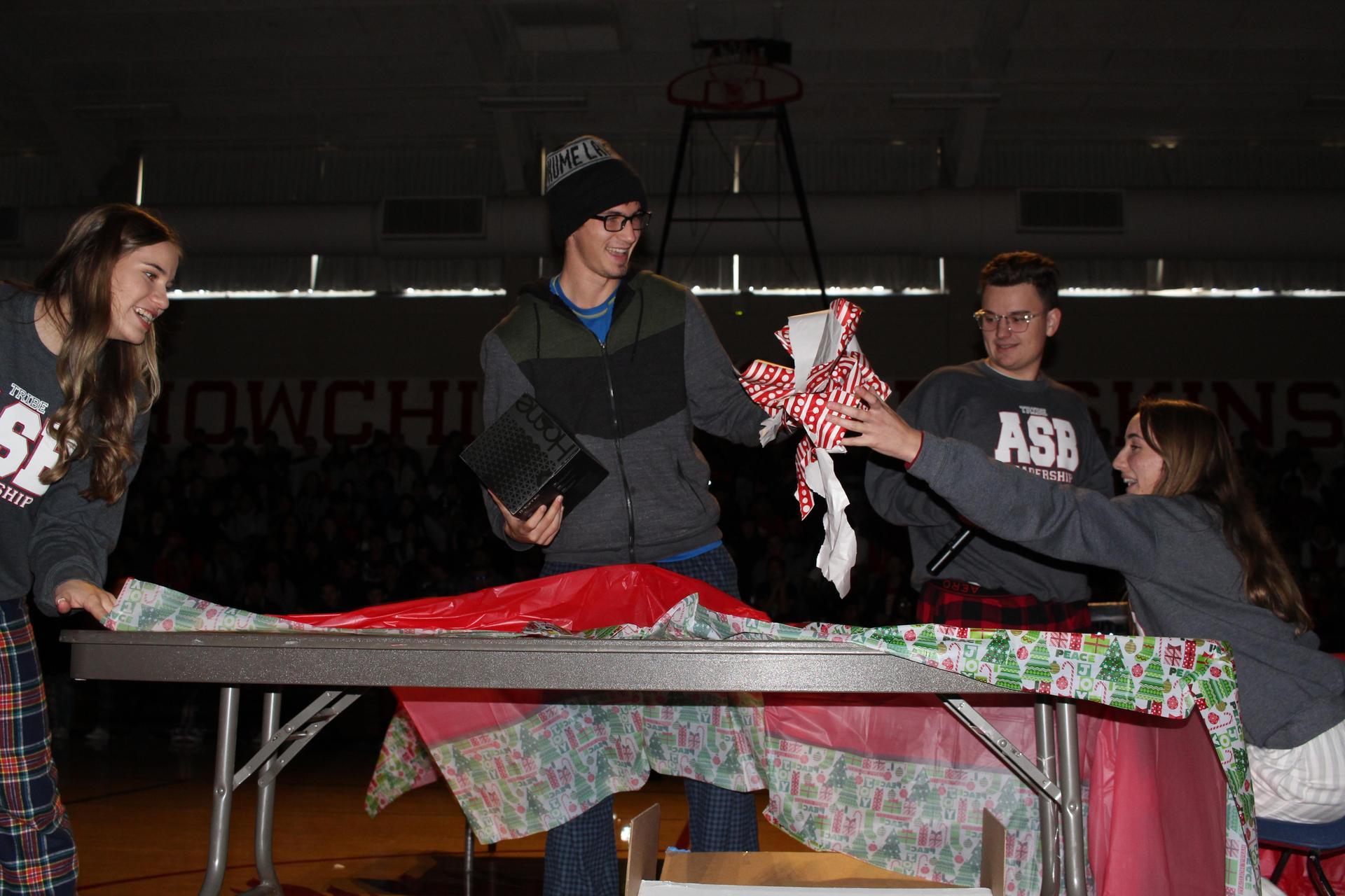Michael Eggert opening his gift