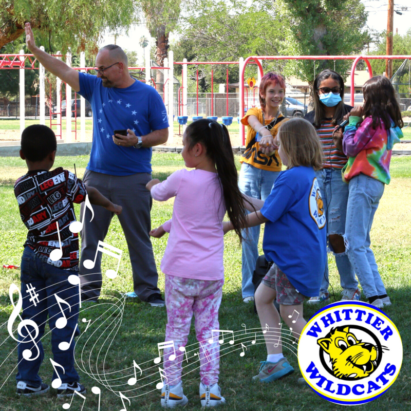 Whittier Counselor Dave Kirkendall and students dancing to Baby Shark