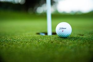 Color photo of pin and golf ball