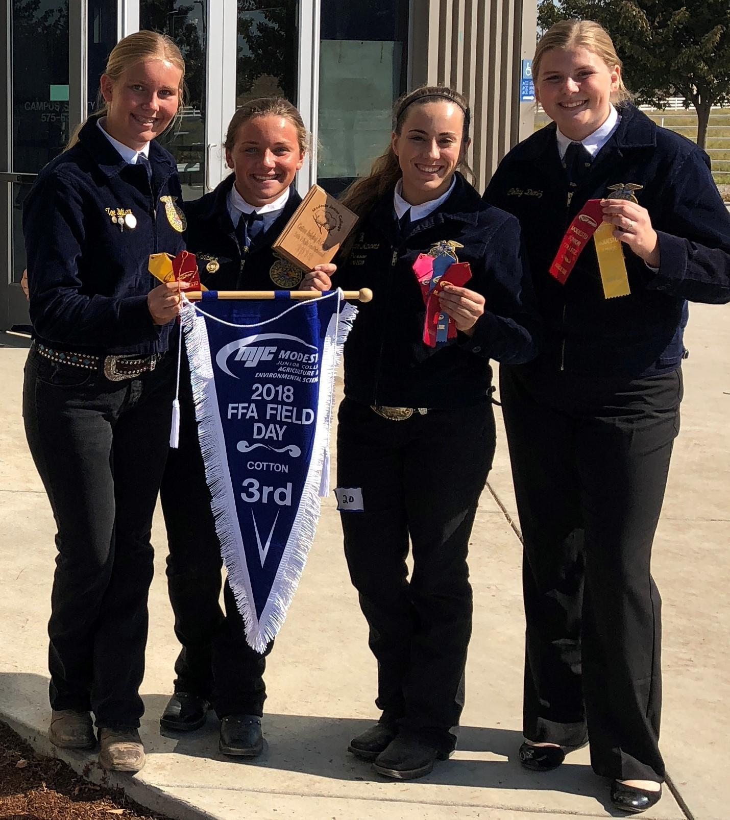 FFA Cotton Judging Team members pose with their awards after the competition at Modesto Junior College.