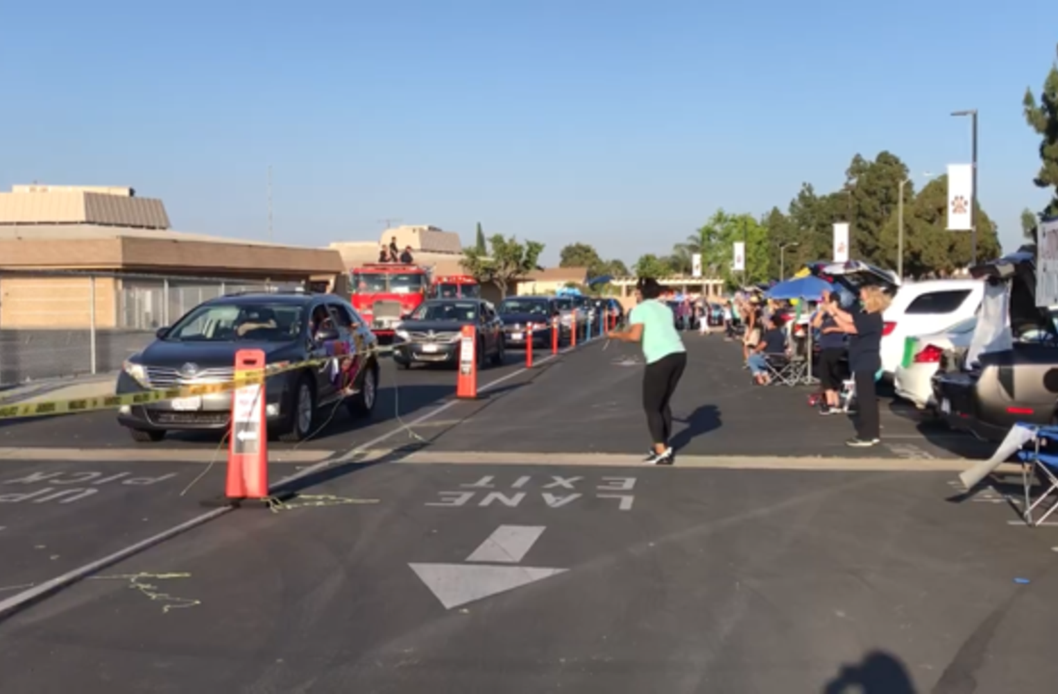 teachers waving at their students in cars