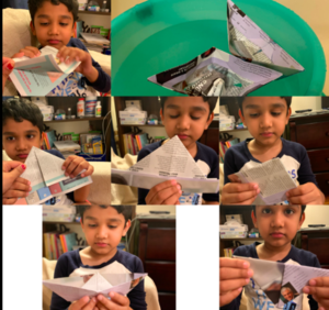 Boy showing steps of making an origami hat
