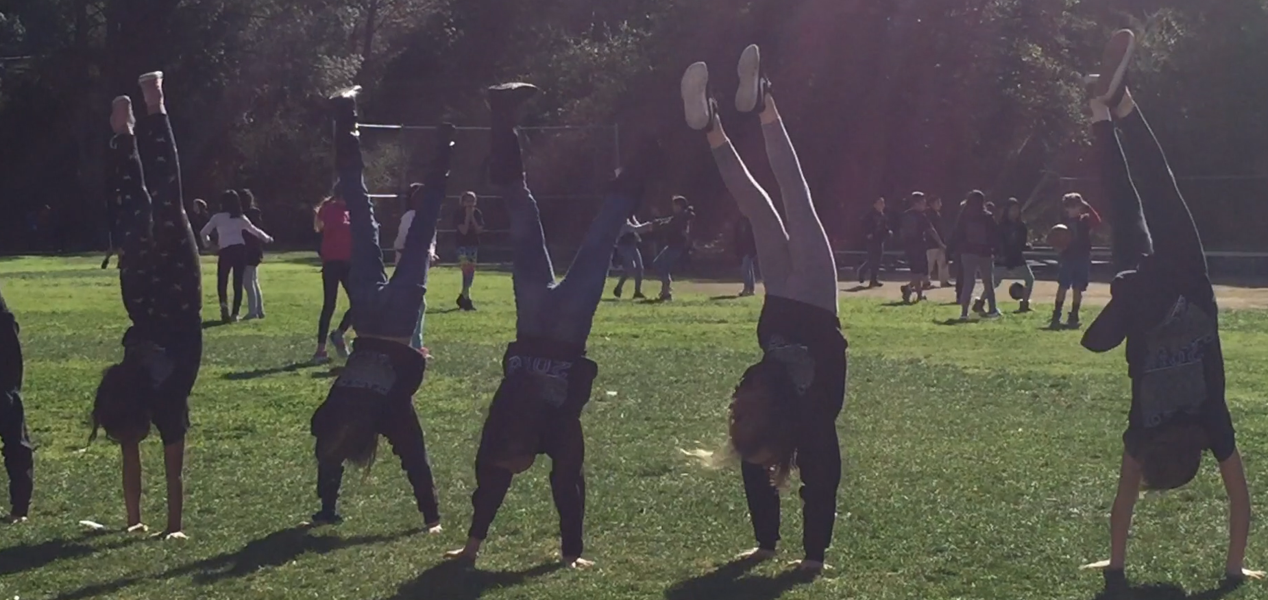 Castlebay Lane Students showing their handstands