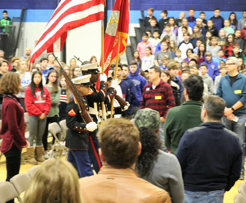 Members of the Combat Logistics Batallion 25, 4th Marine Logistics Group present the colors during Roosevelt Intermediate School's annual Veterans Day assembly on Nov. 12.