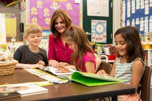 SCEF Teacher Reading with Kids Image