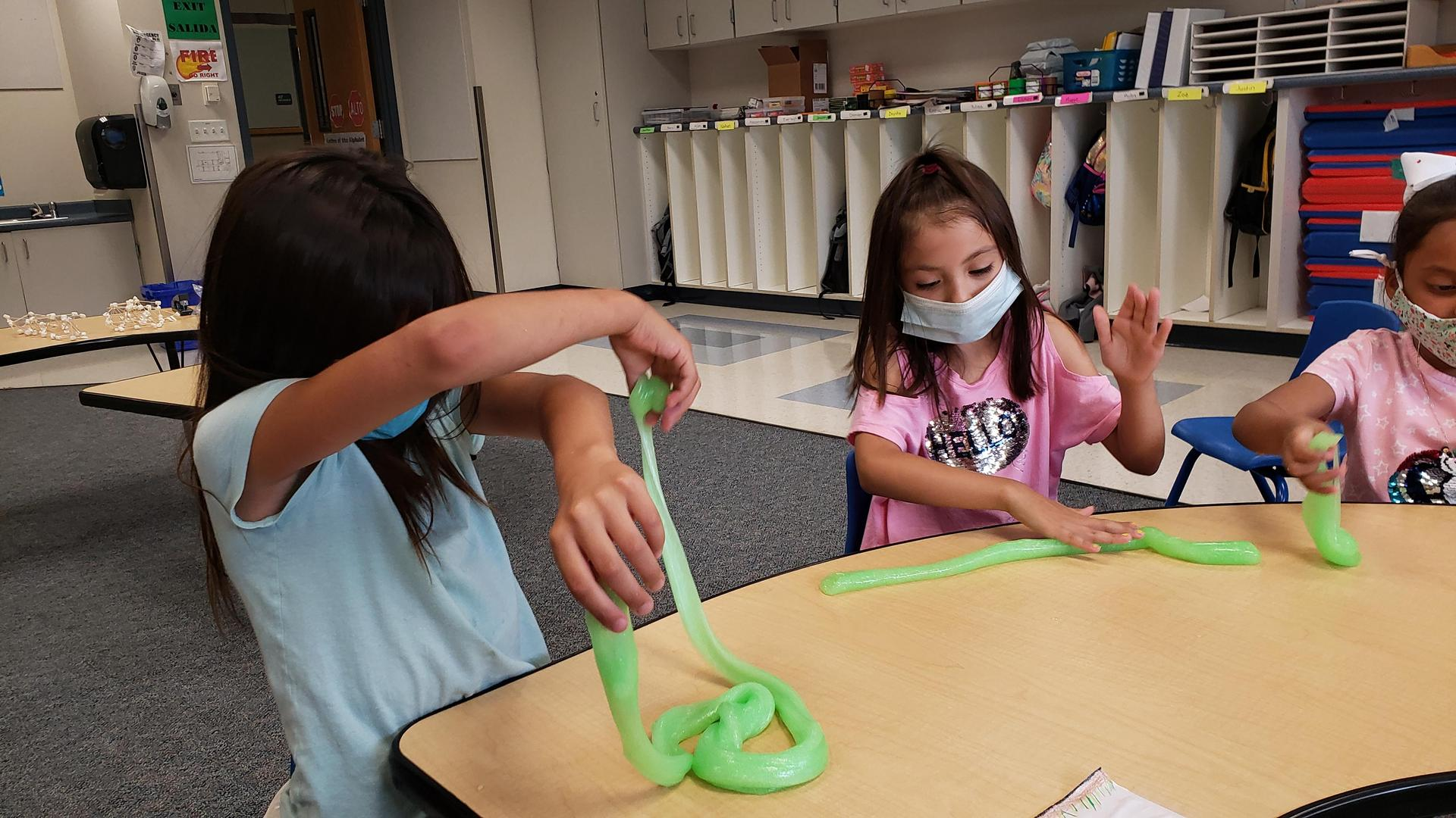 Students experimenting with slime