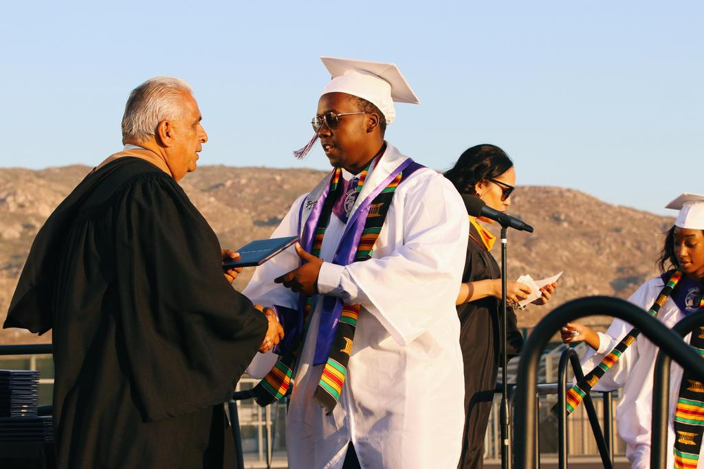 Board of Education President Jesus Holguin congratulates graduate
