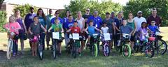 Ten WSISD elementary students won new bikes and helmets as part of Lockheed Martin's 20th annual Perfect Attendance Giveaway.