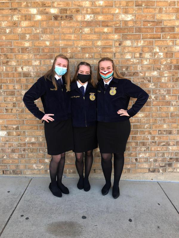 Three FFA students with masks on.