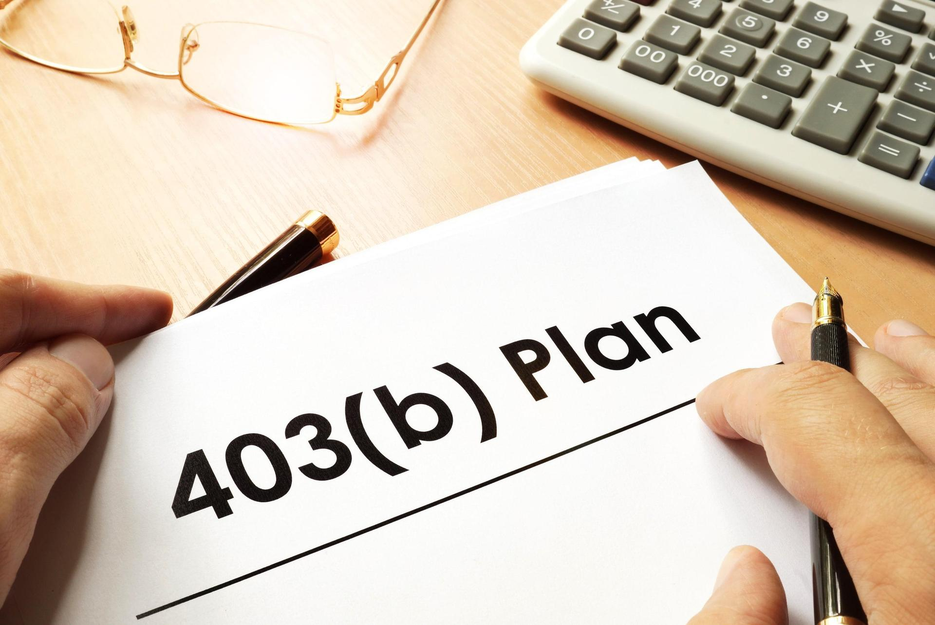 Image of 403(b) Plan by the hands of an investor.