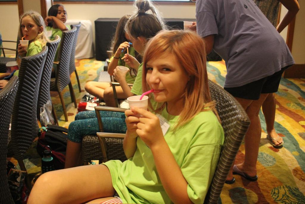 girls sipping through straw