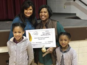 CES Teacher November Golden Apple Winner Gwen Rockette with her daughters and co-worker, Mrs. Dana Fant.