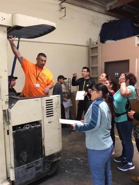 Students observing fork lift guide