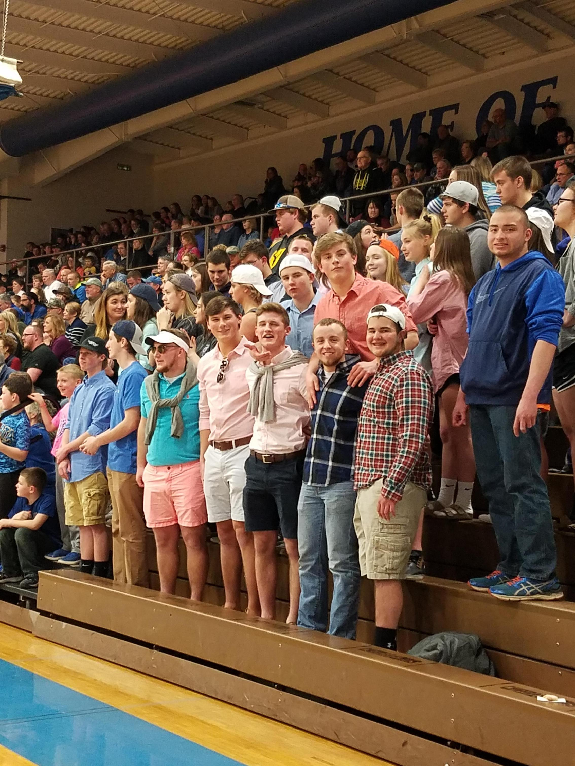 Student section at basketball game.