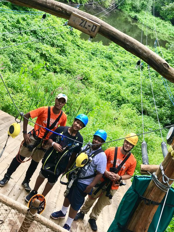 Ready eager and willing to jump into their next zipline adventure.