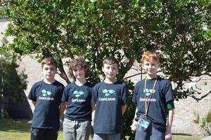 Fourth-graders Abbott Johnson, from left, Boston Riley, Tanner Lochstampfor and Griffin Goldstone organized a new group this year called the Green Leaves Club at Satilla Marsh Elementary to promote sustainability, reforestation and other eco-friendly initiatives.