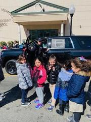 girls lined up to see the canine pd vehicle