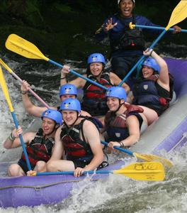 Mrs. Trometter and Ms. Campbell in a group white water rafting.