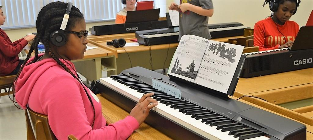Learning piano in the Music Lab
