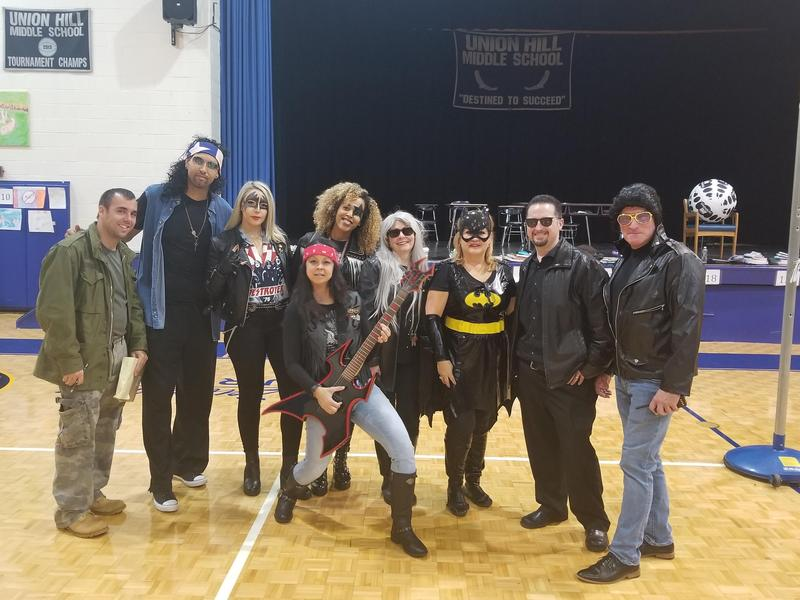 UHMS Admin dressed as rockers and super heros