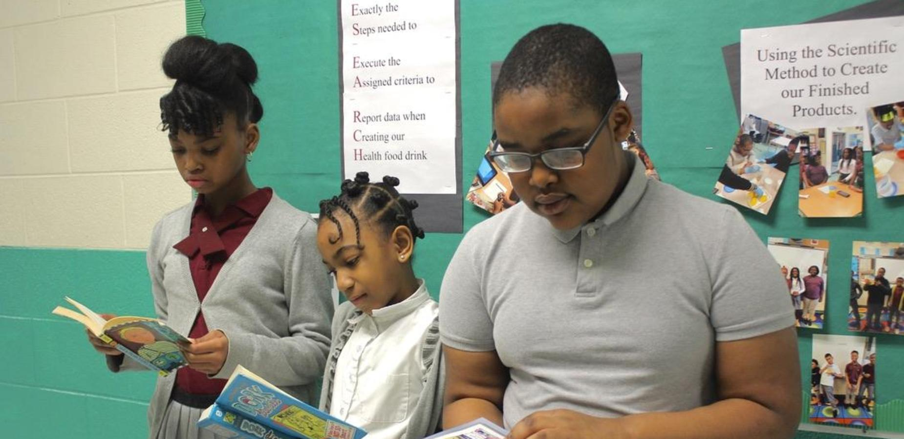 Scholars engaged in reading.