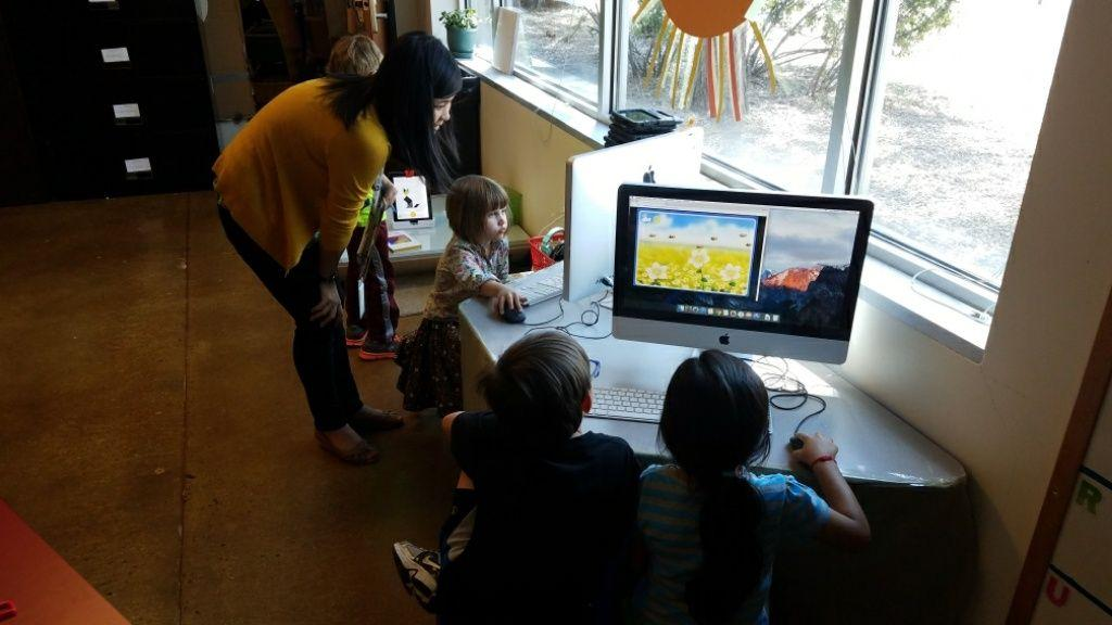 Kindergarteners learn how to use a computer mouse by playing a bee pollination game.