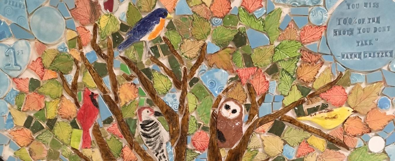 Detail of TGG tile mosaic featuring birds in tree