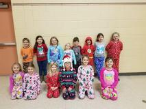 Students in pajamas smiling