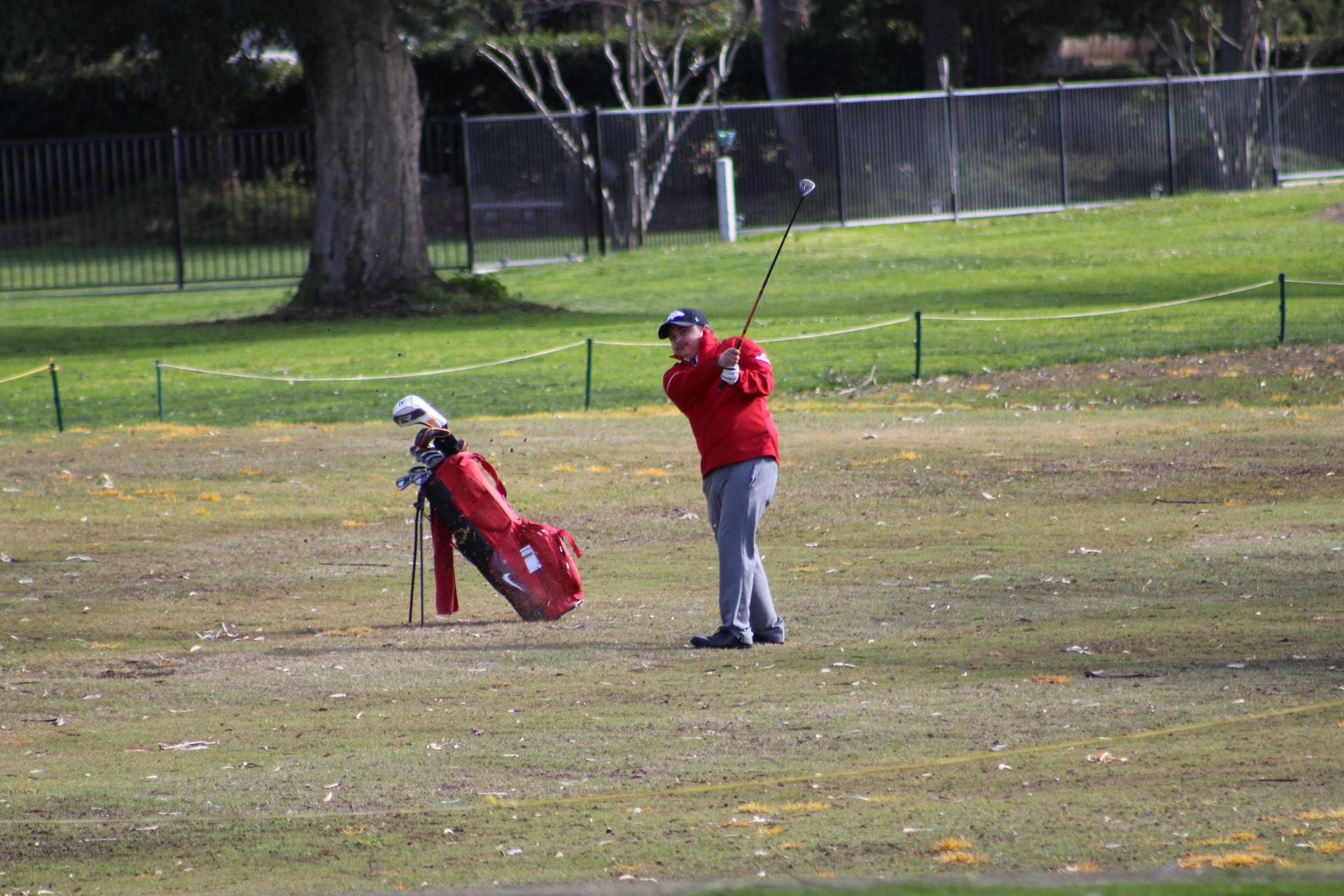 Boys golfing against Madera