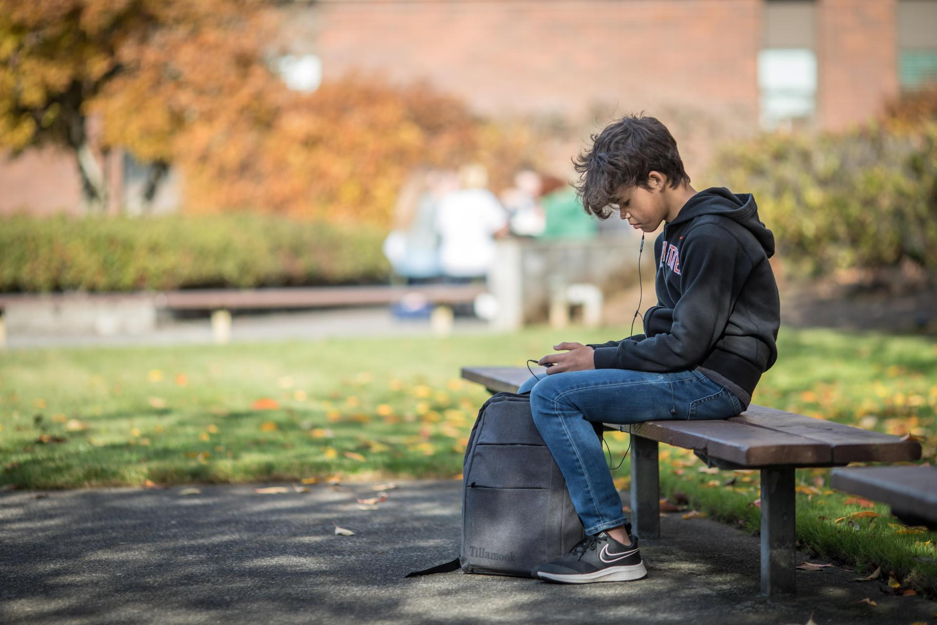 student sitting on a bench outside