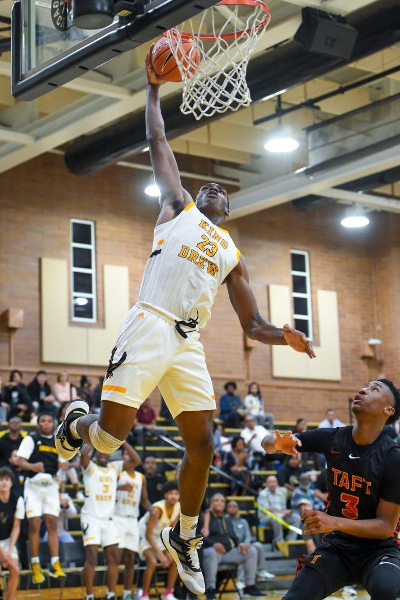 King/Drew's Fidelis Okereke rises for a dunk as Taft's Jason Hart Jr. watches. (Michael Owen Baker / For The Times)