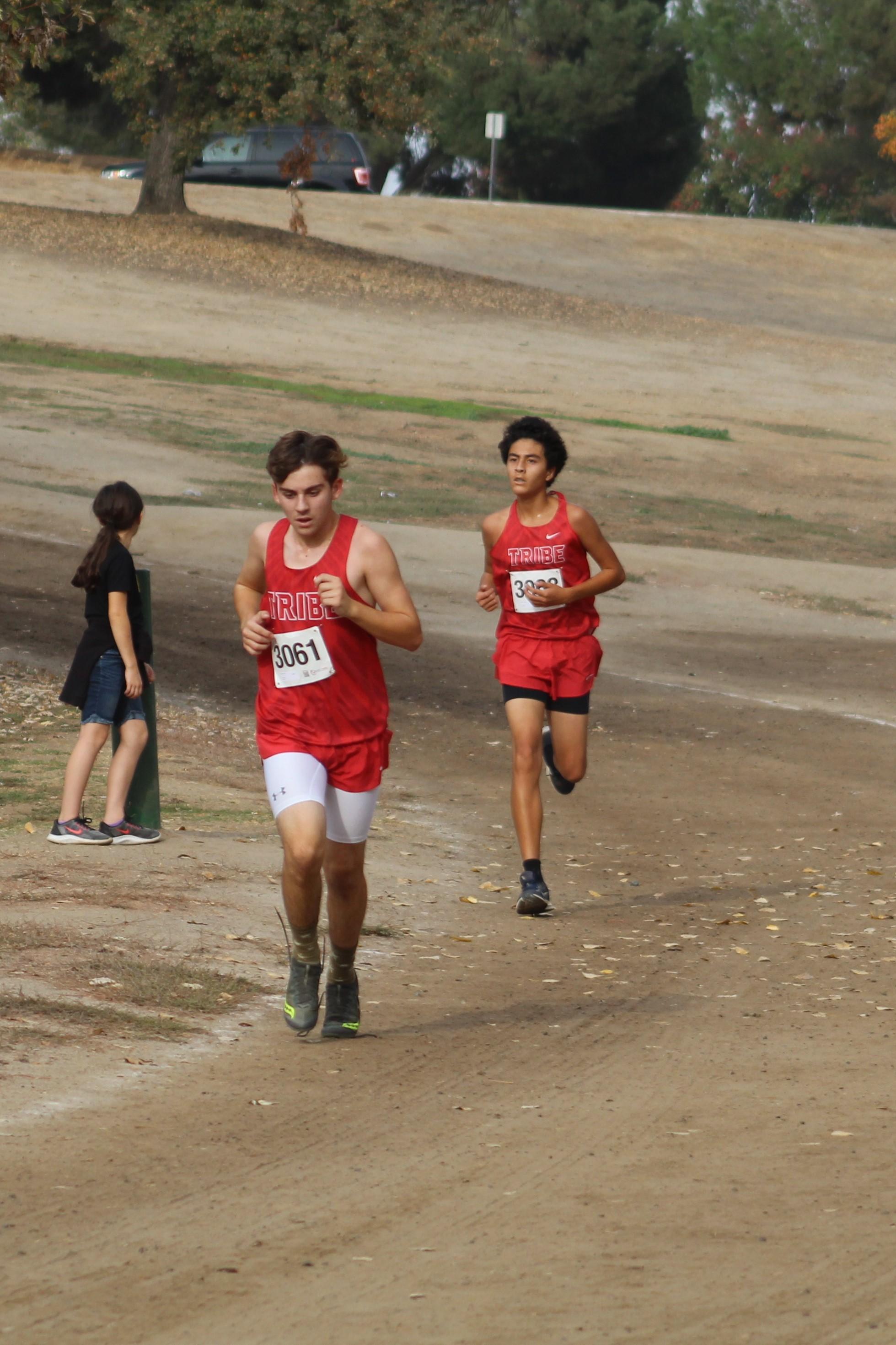 Carson Borba and Nicholas Lopez running