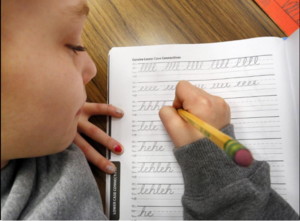 Photo of child writing in cursive