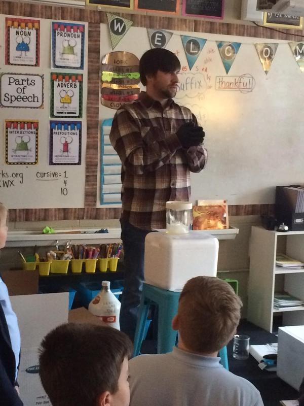 Microbiologist explaining solids, liquids, and gases