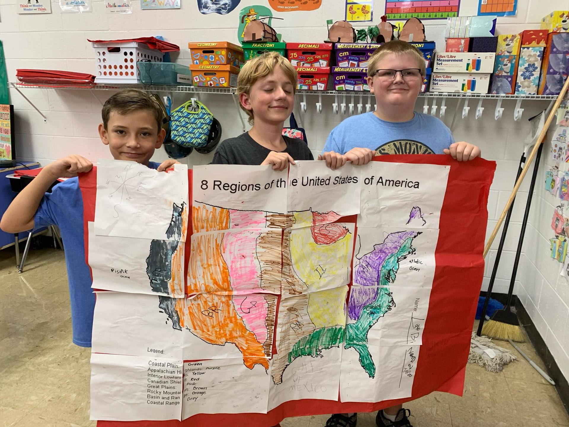 students display completed puzzle map describing the geographic features of  the eight regions of the United States.