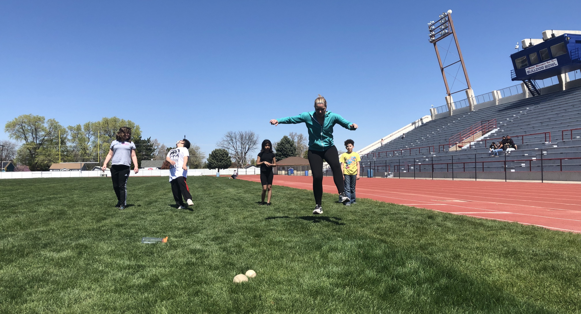 Coach Higgins practicing for the track meet with fifth-grade students.